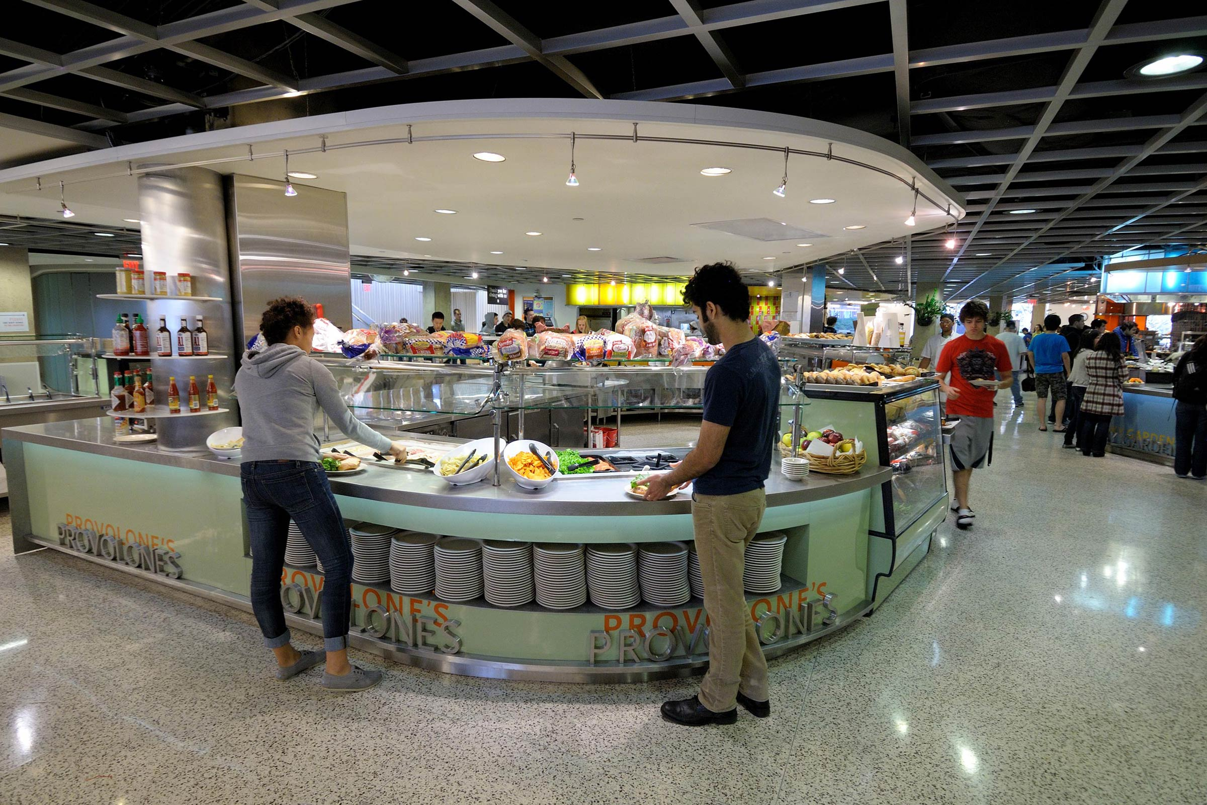 Students take food from buffet-style counter at Pennsylvania Avenue Residence Hall's dining hall.